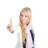 Muchacha rubia que muestra el dedo índice Fotografía de archivo