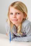 Muchacha rubia sonriente Foto de archivo libre de regalías