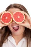Muchacha rubia y linda con la naranja Fotos de archivo libres de regalías