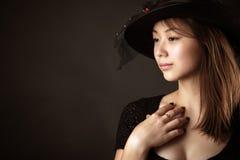 Muchacha rusa coreana del adolescente con el sombrero Imágenes de archivo libres de regalías