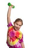 Muchacha sana con pesas de gimnasia aislada en blanco Foto de archivo libre de regalías