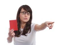 Muchacha seria con el papel rojo a disposición Imagen de archivo libre de regalías