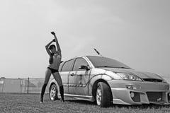 Muchacha sexual y el coche de deportes Fotografía de archivo