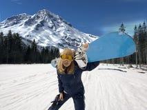 Muchacha - snowboarder Imagenes de archivo