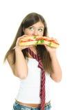 Muchacha soñadora que come un sandwitch Fotos de archivo libres de regalías