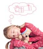 Muchacha soñolienta con el oso de peluche Foto de archivo libre de regalías