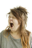 Muchacha soñolienta que bosteza Imagen de archivo libre de regalías