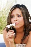 Muchacha sola con una flor Imagenes de archivo