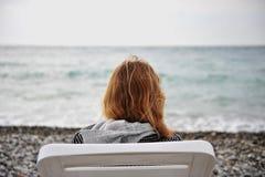 Muchacha sola en el mar Fotografía de archivo