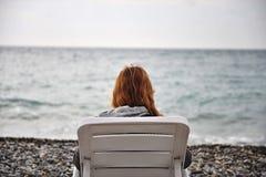 Muchacha sola en el mar Imagen de archivo