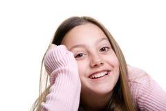 Muchacha sonriente aislada en blanco Fotos de archivo