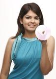Muchacha sonriente con el CD Fotografía de archivo