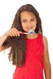 Muchacha sonriente con el cepillo de dientes foto de archivo libre de regalías
