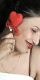 Muchacha sonriente con el corazón Fotografía de archivo libre de regalías
