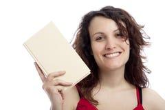 Muchacha sonriente con el libro Fotos de archivo