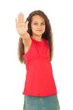Muchacha sonriente con la mano de la parada Foto de archivo libre de regalías