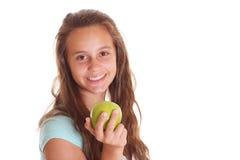 Muchacha sonriente con la manzana Fotografía de archivo libre de regalías