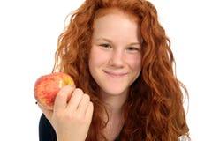 Muchacha sonriente con la manzana Fotos de archivo