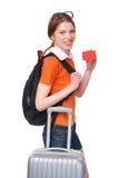 Muchacha sonriente con la mochila y la maleta Fotos de archivo libres de regalías
