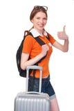 Muchacha sonriente con la mochila y la maleta Fotos de archivo