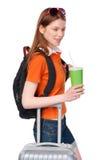 Muchacha sonriente con la mochila y la maleta Imagen de archivo libre de regalías