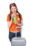 Muchacha sonriente con la mochila y la maleta Foto de archivo