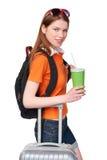 Muchacha sonriente con la mochila y la maleta Imagen de archivo