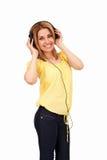 Muchacha sonriente con los auriculares Imagen de archivo