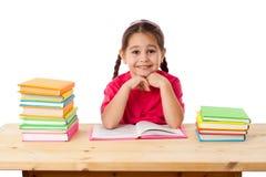 Muchacha sonriente con los libros fotografía de archivo libre de regalías