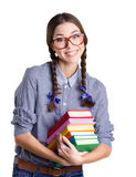 Muchacha sonriente con los libros Imagen de archivo libre de regalías