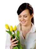 Muchacha sonriente con los tulipanes Imagen de archivo