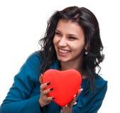 Muchacha sonriente con un corazón Imágenes de archivo libres de regalías
