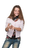Muchacha sonriente con un teléfono celular Foto de archivo libre de regalías