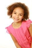 Muchacha sonriente de la raza mixta que mira la cámara Foto de archivo libre de regalías