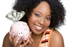 Muchacha sonriente de Piggybank Fotos de archivo