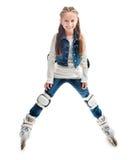 Muchacha sonriente del adolescente en rollerskates Fotos de archivo
