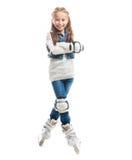 Muchacha sonriente del adolescente en rollerskates Imagenes de archivo