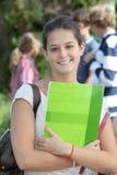 Muchacha sonriente del estudiante Imágenes de archivo libres de regalías