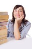 Muchacha sonriente del estudiante con la pila de libros Imagen de archivo libre de regalías