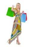Muchacha sonriente en alineada con los bolsos de compras Imágenes de archivo libres de regalías
