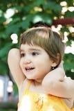 Muchacha sonriente en amarillo Imagen de archivo libre de regalías