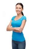 Muchacha sonriente en camiseta azul en blanco Imágenes de archivo libres de regalías