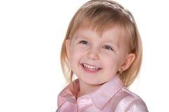 Muchacha sonriente en color de rosa Imágenes de archivo libres de regalías