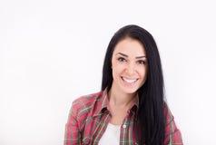 Muchacha sonriente en el fondo blanco Imagenes de archivo