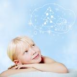 Muchacha sonriente en el sombrero de Papá Noel Imágenes de archivo libres de regalías