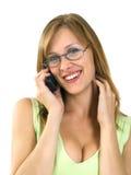 Muchacha sonriente en el teléfono Foto de archivo libre de regalías