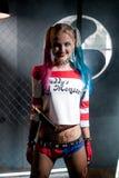 Muchacha sonriente en el traje Harley Foto de archivo