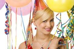 Muchacha sonriente en partido con los globos Foto de archivo libre de regalías