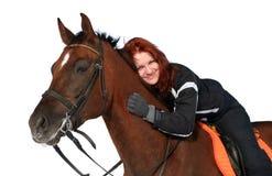 Muchacha sonriente en un lomo de caballo Imágenes de archivo libres de regalías