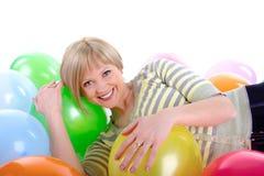 Muchacha sonriente feliz con los globos Foto de archivo